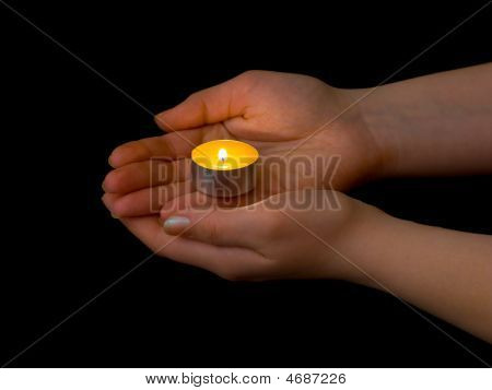 Hands And Burning Candle