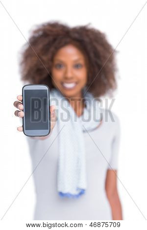 Cheerful woman showing her smartphone on white background