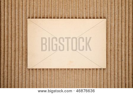 Old Blank Postcard On Corrugated Cardboard Background