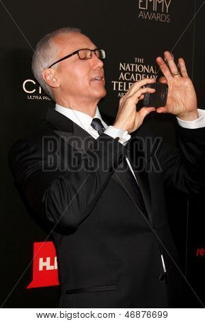 LOS ANGELES - JUN 16:  Dr Drew Pinsky arrives at the 40th Daytime Emmy Awards at the Skirball Cultural Center on June 16, 2013 in Los Angeles, CA