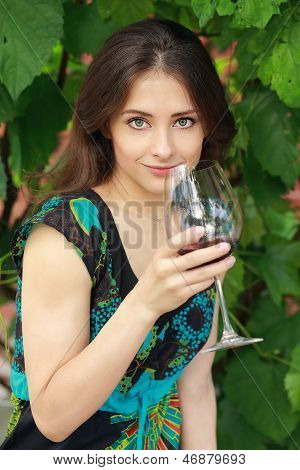 Beautiful Woman Drinking Red Wine In Park On Nature Green Background