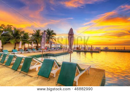 KOH KHO KHAO, THAILAND - NOV 15: Sunset at swimming pool of Andaman Princess Resort & SPA. Hotel was destroyed by tsunami in 2004 and rebuild, Koh Kho Khao, Phang Nga in Thailand on Nov. 15, 2012.