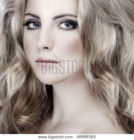 Closeup portrait of sexy whiteheaded young woman with beautiful blue eyes