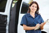 image of driver  - Portrait Of Female Delivery Driver With Clipboard - JPG