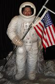 stock photo of droopy  - man at carnival in goofy plastic astronaut - JPG