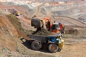 stock photo of dredge  - Loading of iron ore on very big dump - JPG