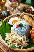 Nasi kerabu is a type of nasi ulam, popular delicious Malay rice dish. Blue color of rice resulting
