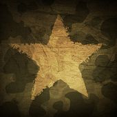 stock photo of camo  - Military camouflage background with grunge star - JPG