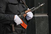 foto of kalashnikov  - hands in white gloves with a Kalashnikov assault rifle - JPG