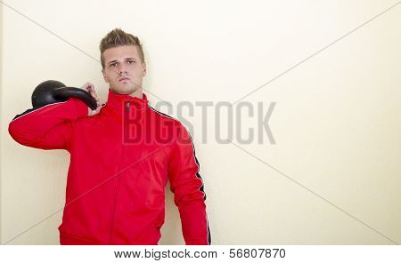 Serious Young Man (personal Trainer Or Athlete) In Tracksuit