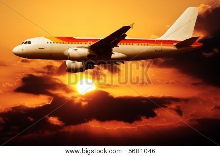 Airplane In A Sunset