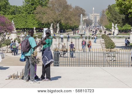 Black Man Souvenirs Seller In Jardin Des Tuileries - Paris, France.