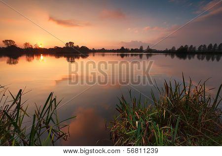 Gold Sunrise Over Lake
