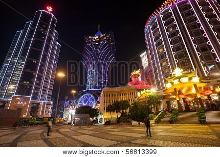 MACAU, CHINA - OCTOBER 31, 2012: Bank of China, casino Grand Lisboa and Lisboa evening. Macau is the gambling capital of Asia and attends approximately 29 million tourists annually.