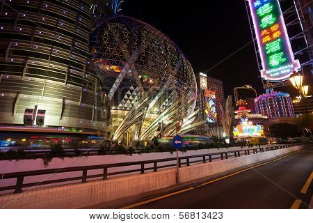 MACAU, CHINA - OCTOBER 31, 2012: Casino Grand Lisboa, Lasboa evening. Macau is the gambling capital of Asia and attends approximately 29 million tourists annually.