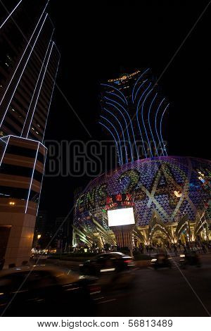MACAU, CHINA - OCTOBER 31, 2012: Casino Grand Lisboa - one of the biggest and most popular casino. Macau is the gambling capital of Asia and attends approximately 29 million tourists annually.