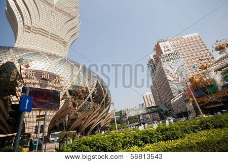 MACAU, CHINA - NOVEMBER 2, 2012: Popular casinos Grand Lisboa and Lisboa Casino. Macau is the gambling capital of Asia and is visited by about 29 million people every year.