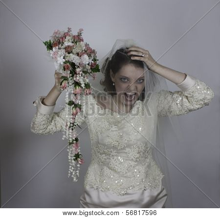 Young bride snarling like a bridezilla