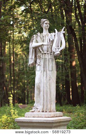 Woman Sculpture In Park