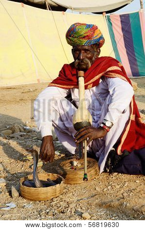 Nomad snake charmer playing at camel mela,Pushkar,India