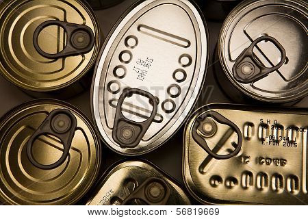 Tins of different sizes and closed isolated on white background