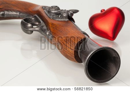 Old Gun And Red Heart