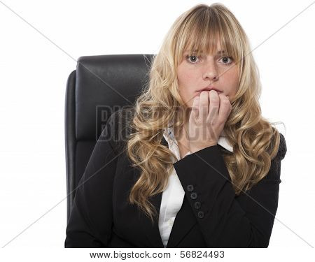 Businesswoman Biting Her Nails In Trepidation