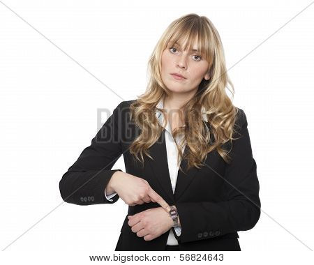 Young Businesswoman Pointing To Her Watch
