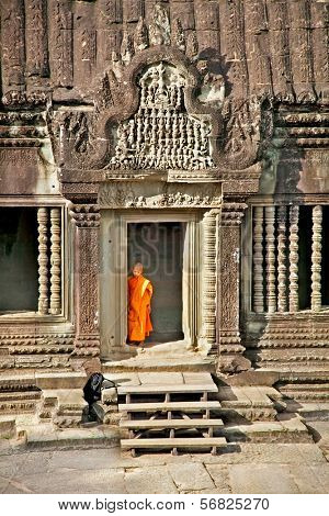 ANGKOR WAT, CAMBODIA - NOV 20,2013: Unidentified Buddhist monk in Angkor Wat complex on Nov 20, 2013.Cambodia. Angkor Wat was first a Hindu, then subsequently, a Buddhist temple complex in Cambodia.