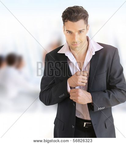 Portrait of a young confident businessman in office setting