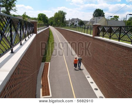 Retired Couple Walking on a Paved Trail