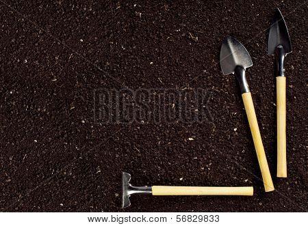 Organic soil and spade and rake