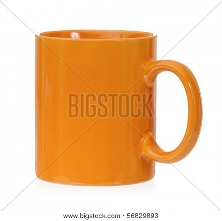 Orange mug empty blank for coffee or tea, isolated on white background