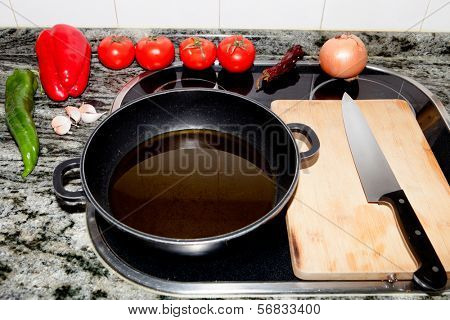 Ingredients prepared for cooking on a kitchen worktop