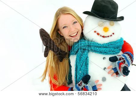 Woman And Snowman Outside In Winter