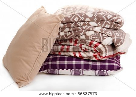 Warm plaids and pillows isolated on white