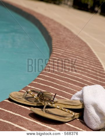 Flip-flop And A Towel By A Pool