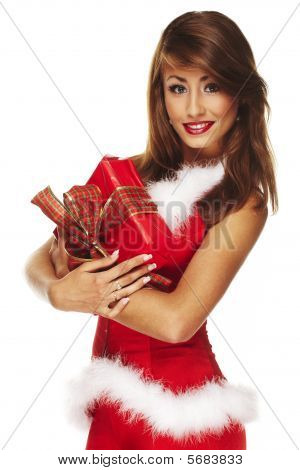 Closeup Of A Cute Santa Lady Holding A Gift Isolated On White