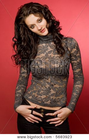 Girl In Transparent Clothing Over Red Background