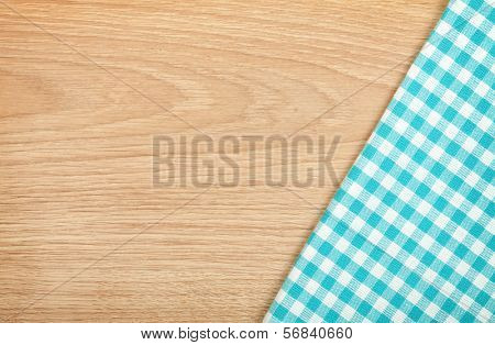 Kitchen towel on wooden table with copy space