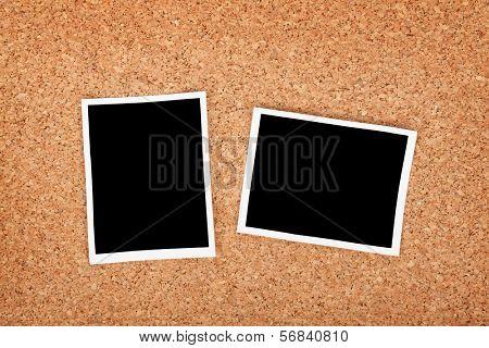 Polaroid photo frames on cork texture background