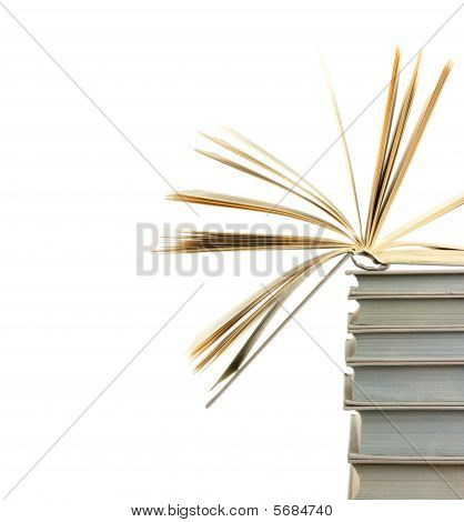 A Pile Of Books And The One Open At Top