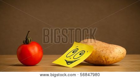 Potato with sticky post-it note reacting on tomato
