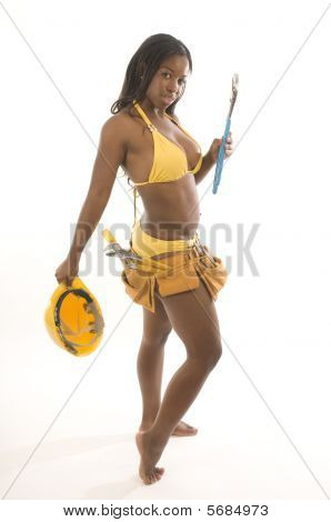 Young Pretty Hispanic African American Woman Contractor Bikini And Tools