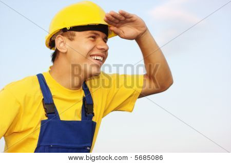 Worker Looking Forward, Covering Eyes From The Sun