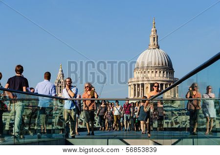 LONDON, UK - CIRCA OCTOBER 2011: People walking on The Millennium Bridge with St Paul's cathedral in the background.
