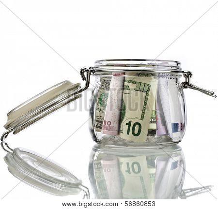 Money jar full of savings  isolated on white background