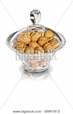 Nutmegs In Glass Jar On White Background