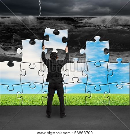 Businessman Holding Puzzles To Assembly Turning Bad Situation