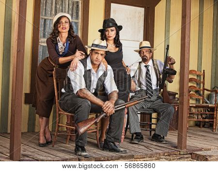 Four Armed Gangsters Sitting